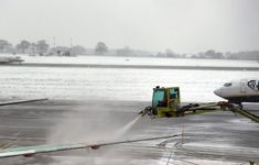 British airports cancel dozens of flights after heavy snow and ice